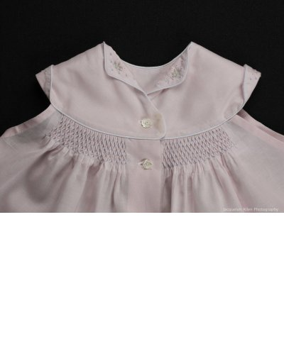 A smocked and embroidered diaper shirt